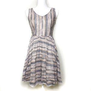 Mystery Sleeveless V-neck babydoll dress. small.